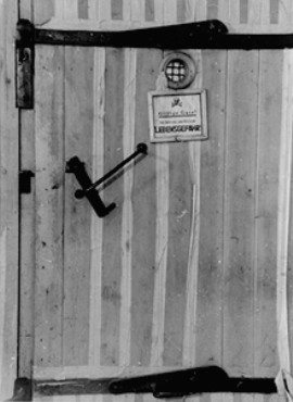 A door to a gas chamber in Auschwitz. The note reads: Harmful gas! Entering endangers your life. Image courtesy of USHMM Photo Archives via http://history1900s.about.com/library/holocaust