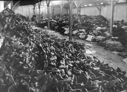An Auschwitz  warehouse filled with shoes and clothing from those who were gassed upon arrival.  Image courtesy of USHMM Photo Archives via http://fcit.usf.edu/holocaust