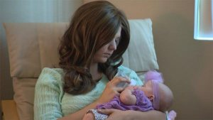 Ashley and two-month-old daughter, Paisley, in their California home.  Image courtesy of CNN.